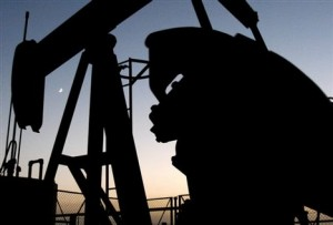Oil hovers near $103 amid mixed US supply signs