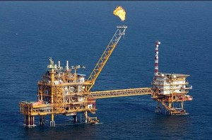 Oil holds near 2012 low