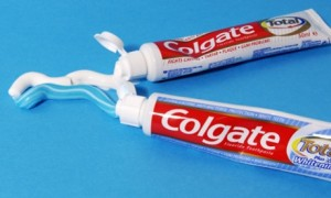 The toothpaste tube and the toothbrush