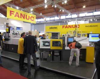 Fanuc demonstrated two-component technology and automated manufacturing cells